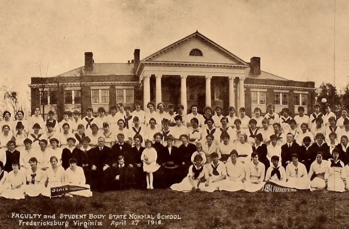 Photograph from June 1917 showing the faculty and students of the Fredericksburg State Normal School posed in front of a building.